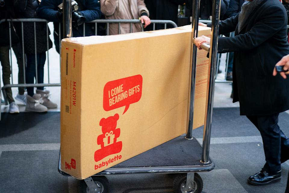 A large box from eco-friendly nursery furniture label Babyletto was photographed being delivered to the hotel prior to Meghan's show [Photo: Getty]