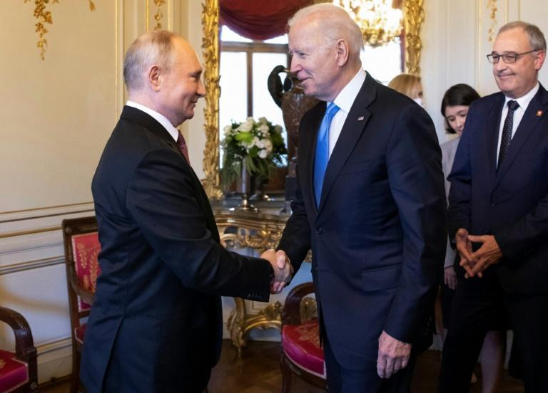 Human contact -- Joe Biden and Vladimir Putin greet one another with a traditional handshake at their summit in Geneva