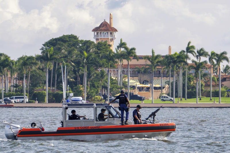 FILE - In this Nov. 22, 2018 file photo, a U.S. Coast Guard patrol boat passes President Donald Trump's Mar-a-Lago estate in Palm Beach, Fla. University of Wisconsin student Mark Lindblom has pleaded guilty to sneaking into Mar-a-Lago last fall during one of President Donald Trump's visits to his Florida club. Lindblom apologized Tuesday, May 28, 2019 and received a year's probation after prosecutors agreed he meant no harm.  (AP Photo/J. David Ake, File)