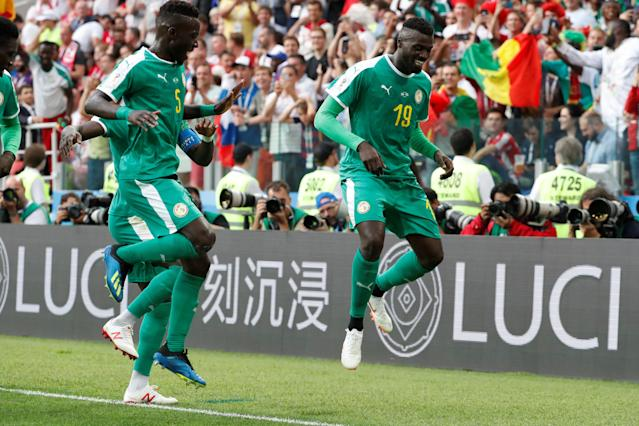 Soccer Football - World Cup - Group H - Poland vs Senegal - Spartak Stadium, Moscow, Russia - June 19, 2018 Senegal's M'Baye Niang celebrates scoring their second goal with Idrissa Gueye REUTERS/Grigory Dukor