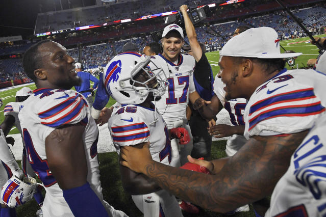"""Buffalo Bills' Christian Wade (45), center, celebrates his touchdown with teammates during the second half of an NFL preseason football game against the Indianapolis Colts, Thursday, Aug. 8, 2019, in Orchard Park, N.Y. Wade gave up a promising career representing England in rugby to give American football a try. On his first play from scrimmage in a competitive setting, the 28-year-old from Slough _ best known for home of the BBC's version of """"The Office"""" sitcom _ scored a touchdown on a 65-yard run to help the Buffalo Bills secure a 24-16 preseason-opening win over Indianapolis. (AP Photo/Adrian Kraus)"""