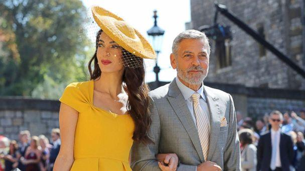 PHOTO: Amal Clooney and George Clooney arrive for the wedding ceremony of Prince Harry and Meghan Markle at St. George's Chapel in Windsor Castle in Windsor, May 19, 2018. (Gareth Fuller/AP)