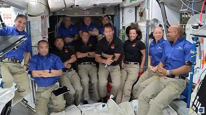 The expanded 11-member station crew crowded together for a post-docking portrat. Left to right in blue shirts: Michael Hopkins, Soichi Noguchi, Mark Vande Hei, Oleg Novitskiy, Pyotr Dubrov, Shannon Walker and Victor Glover. Left to right in black shirts: Akihiko Hoshide, Shane Kimbrough, Thomas Pesquet and Megan McArthur. / Credit: NASA TV