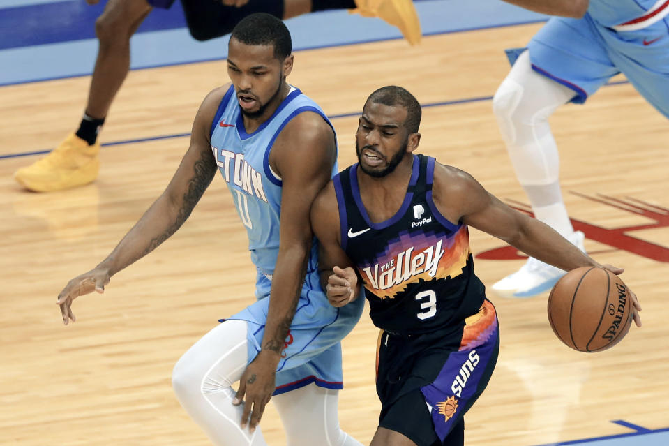 Phoenix Suns guard Chris Paul (3) collides with Houston Rockets guard Sterling Brown during the second half of an NBA basketball game Wednesday, Jan. 20, 2021, in Houston. (AP Photo/Michael Wyke)