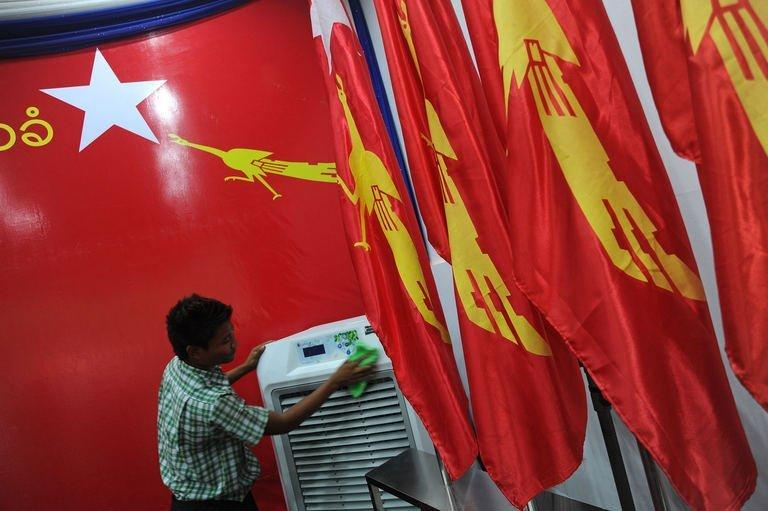 A worker puts the final touches to the venue of the National League for Democracy (NLD) party congress, at the Royal Rose Hall in Yangon, on March 7, 2013. Suu Kyi's long-silenced opposition opened its first ever party conference on Friday, as it sets its sights on the challenges of power in Myanmar after years in the political wilderness