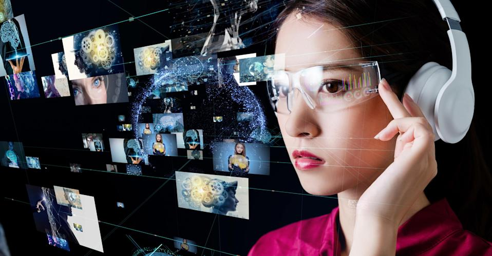 A woman wears headphones and glasses that show video images that fly by her face.