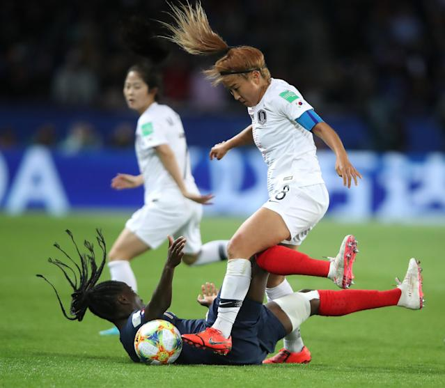 Griedge Mbock Bathy of France is challenged by Sohyun Cho of Korea Republic during the 2019 FIFA Women's World Cup France group A match between France and Korea Republic at Parc des Princes on June 07, 2019 in Paris, France. (Photo by Alex Grimm/Bongarts/Getty Images)