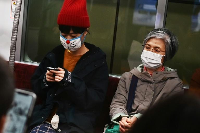Japan's government has urged the cancellation, delay or downsizing of major events in coming weeks to limit the spread of the virus (AFP Photo/CHARLY TRIBALLEAU)