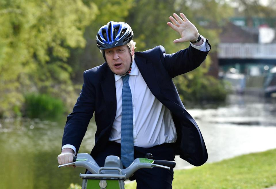 Boris Johnson rides a bike on the towpath of the Stourbridge canal  during a Conservative party local election visit on WednesdayPOOL/AFP via Getty Images