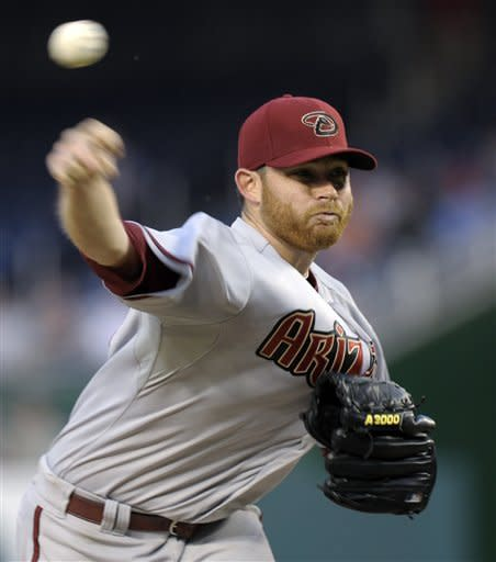 Arizona Diamondbacks starter Ian Kennedy delivers a pitch to the Washington Nationals during the second inning of a baseball game at Nationals Park in Washington, Thursday, May 3, 2012. (AP Photo/Susan Walsh)