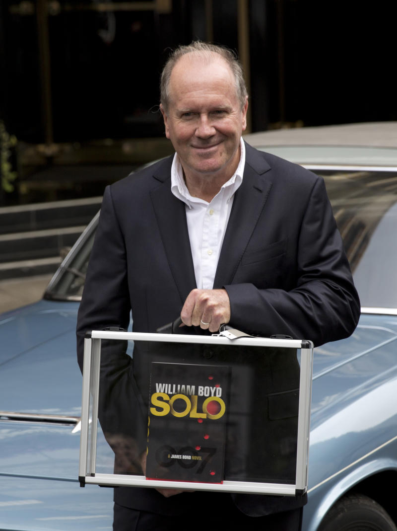 """William Boyd, the author of the new James Bond novel """"Solo"""" poses for photographers, during a launch photocall outside the Dorchester Hotel in London, Wednesday, Sept. 25, 2013. """"Solo"""" is set in 1969 and takes the suave British spy, 45 years old and feeling his age, from London's plush Dorchester Hotel to a war-torn West African country and to Washington. (AP Photo/Matt Dunham)"""