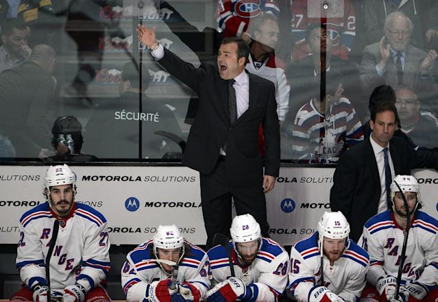 New York Rangers coach Alain Vigneault pulls his goaltender during the third period of Game 5 of the NHL hockey Stanley Cup playoffs Eastern Conference finals against the Montreal Canadiens, Tuesday, May 27, 2014, in Montreal. Montreal won 7-4. (AP Photo/The Canadian Press, Ryan Remiorz)