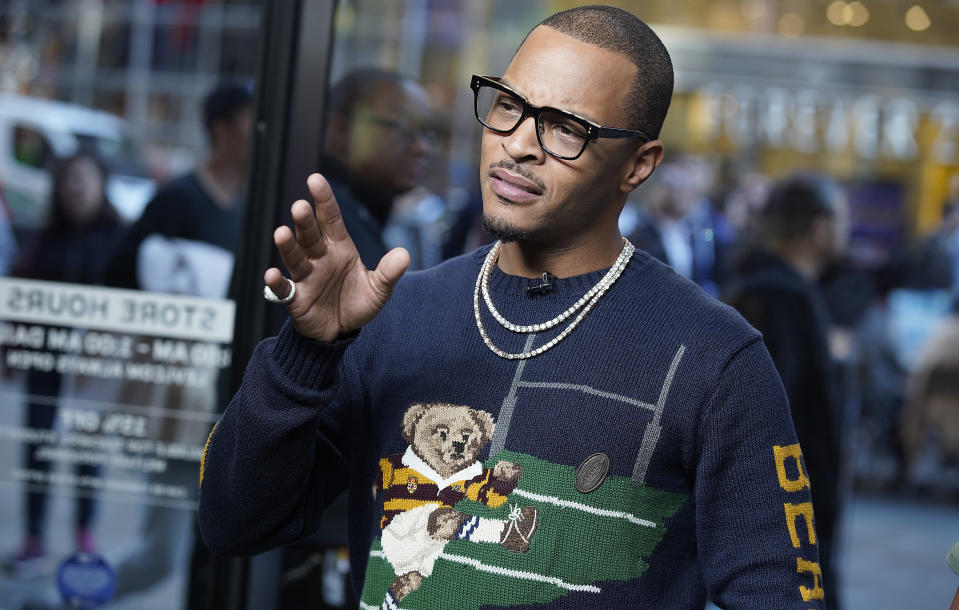 """NEW YORK, NEW YORK - OCTOBER 24: TI and The Smoke winner of Rhythm And Flow Season One visit """"Extra"""" at The Levi's Store Times Square on October 24, 2019 in New York City. (Photo by John Lamparski/Getty Images)"""