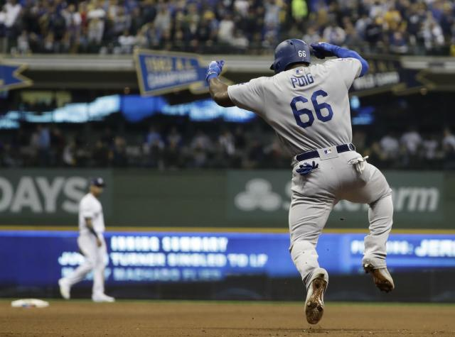 Yasiel Puig was very excited about his three-run home run. (AP)