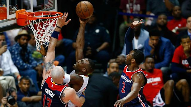 An improbable bucket with 4:58 left in the fourth quarter by Paul Millsap punctuated the Hawks' 111-101 victory over the Wizards in Game 4.