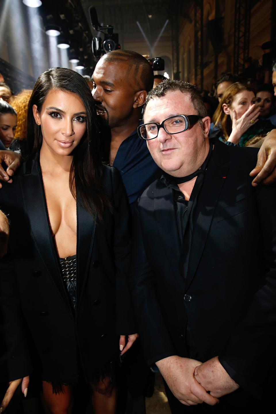 Kim Kardashian, Kanye West and Alber Elbaz depicted in Paris, France during a 2014 Lanvin fashion show. (Photo: Rindoff/Dufour/French Select/Getty Images)