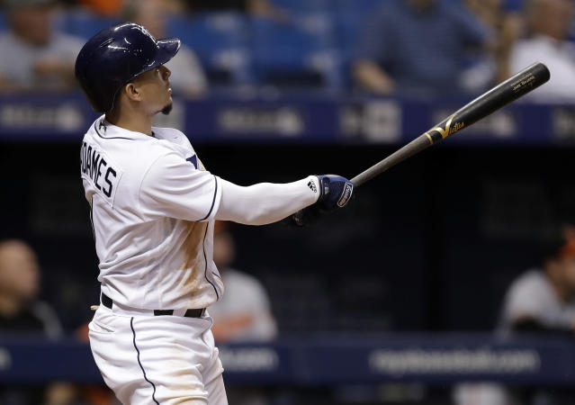 Tampa Bay Rays' Willy Adames watches his walk off-home run off Baltimore Orioles relief pitcher Miguel Castro during a baseball game Tuesday, Aug. 7, 2018, in St. Petersburg, Fla. The Rays won 4-3. (AP Photo/Chris O'Meara)