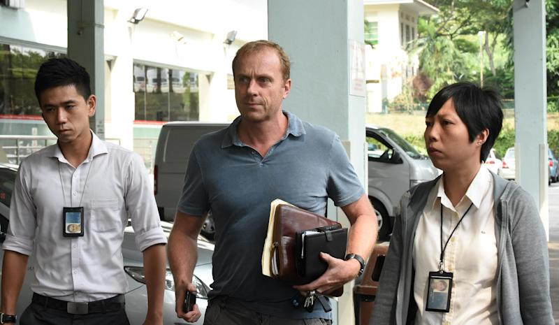 Craig Marran, son-in-law of Antony Kidman who died in Singapore, leaves the mortuary office at Singapore General Hospital, on September 13, 2014 (AFP Photo/Roslan Rahman)