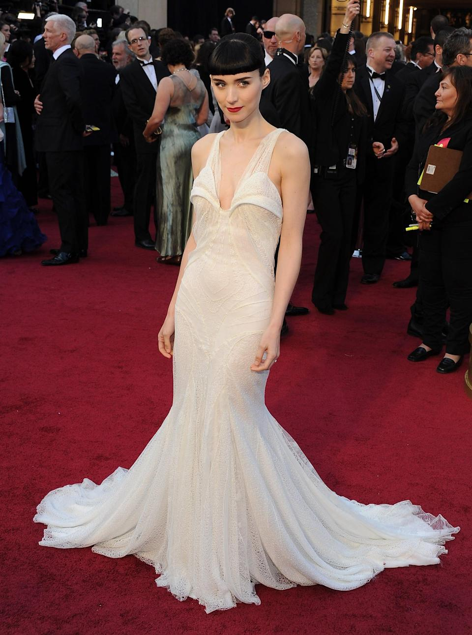 <p>Rooney's elegant white Givenchy gown still had plenty of bite - just like her character in <strong>The Girl With the Dragon Tattoo</strong></p>