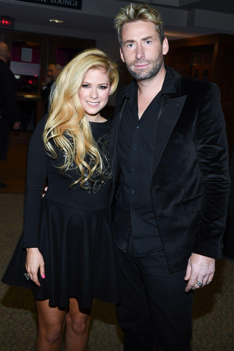 "<p>The singer got engaged to the Nickleback frontman within six months with a 14-carat ring, per <a class=""link rapid-noclick-resp"" href=""https://people.com/celebrity/avril-lavigne-chad-kroeger-engaged/"" rel=""nofollow noopener"" target=""_blank"" data-ylk=""slk:People""><em>People</em></a>. They announced their divorce after two years.</p>"