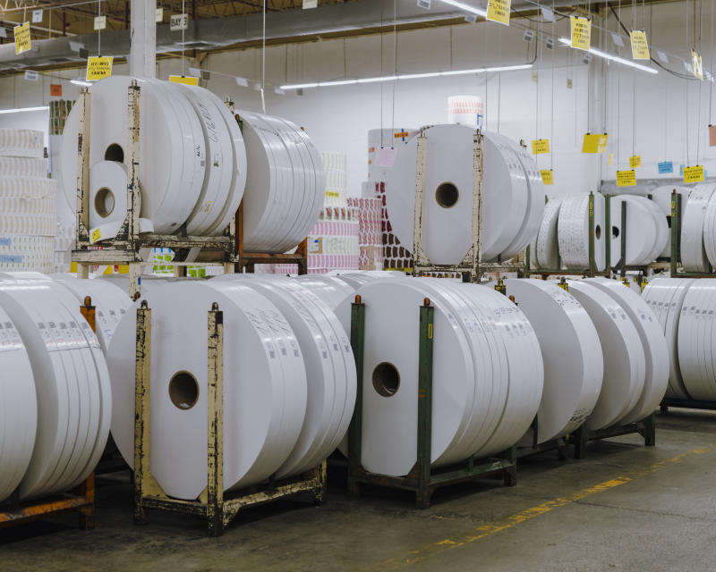 Unprinted rolls of paper in Dart's manufacturing facility in Chicago on Oct. 23, 2019. The Dart Container Corporation, which makes foam products, is a manufacturing behemoth and produced a fortune for the family behind it but environmentalists say its products are polluting the globe. (Lyndon French/The New York Times)