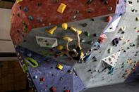 Reaching for the top: Christopher Cosser of South Africa training in Johannesburg for the Olympic bouldering event