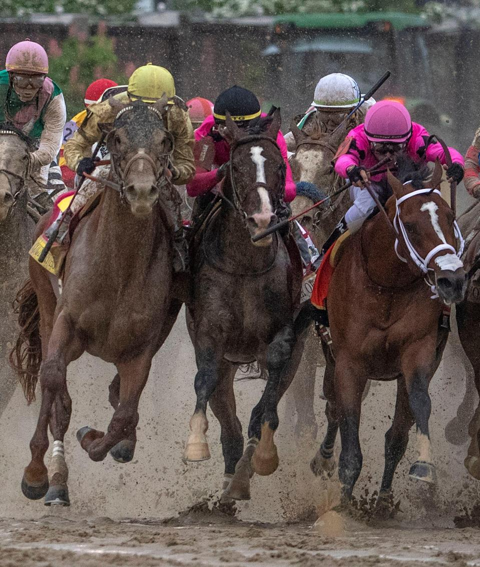 Left to right; Country House, War of Will and Maximum Security bump as they race to the head of the stretch in the Kentucky Derby. The winner Maximum Security was disqualified for causing the incident.
