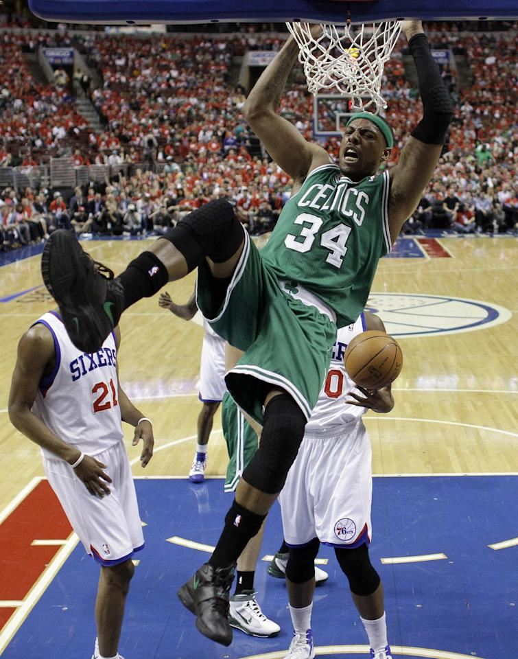 Boston Celtics' Paul Pierce hangs on the rim after a dunk during the first half of Game 3 of an NBA basketball Eastern Conference semifinal playoff series against the Philadelphia 76ers, Wednesday, May 16, 2012, in Philadelphia. (AP Photo/Matt Slocum)