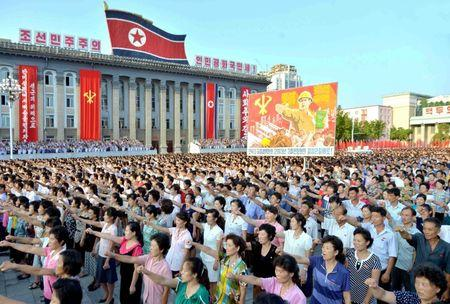 People participate in a Pyongyang city mass rally held at Kim Il Sung Square on August 9, 2017, to fully support the statement of the Democratic People's Republic of Korea (DPRK) government in this photo released on August 10, 2017 by North Korea's Korean Central News Agency (KCNA) in Pyongyang. KCNA/via REUTERS