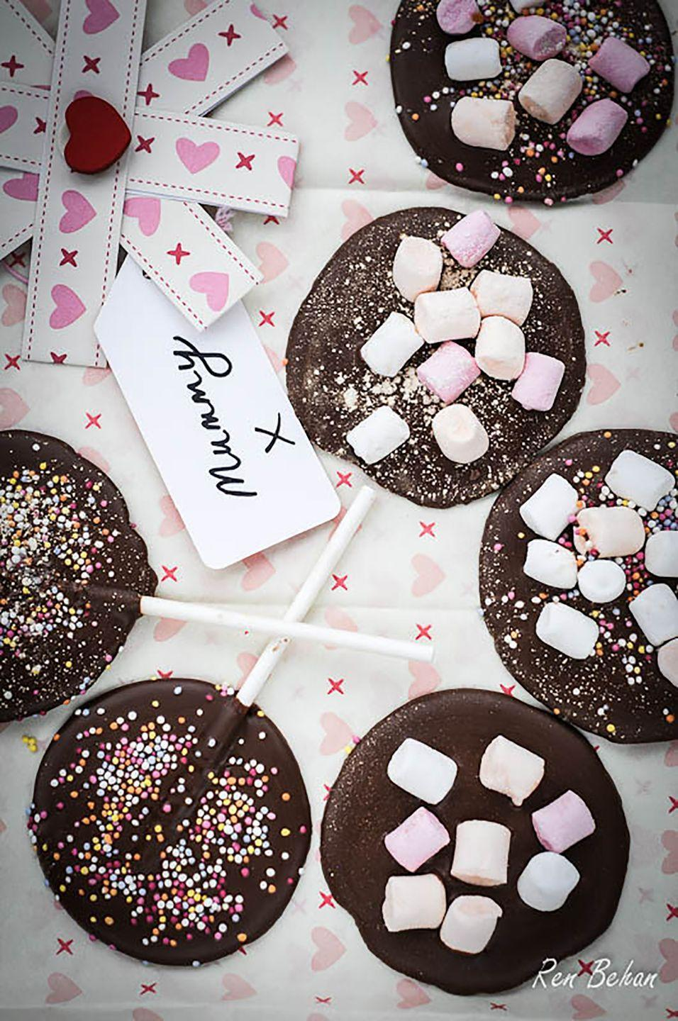 "<p>Chocoholic moms will love munching on these decadent treats, which you can decorate with marshmallows, sprinkles, or a candy of your choice.</p><p><strong>Get the recipe at <a href=""http://www.renbehan.com/2013/03/homemade-mothers-day-chocolates-that-dads-can-help-with.html"" rel=""nofollow noopener"" target=""_blank"" data-ylk=""slk:Ren Behan"" class=""link rapid-noclick-resp"">Ren Behan</a>.</strong></p>"
