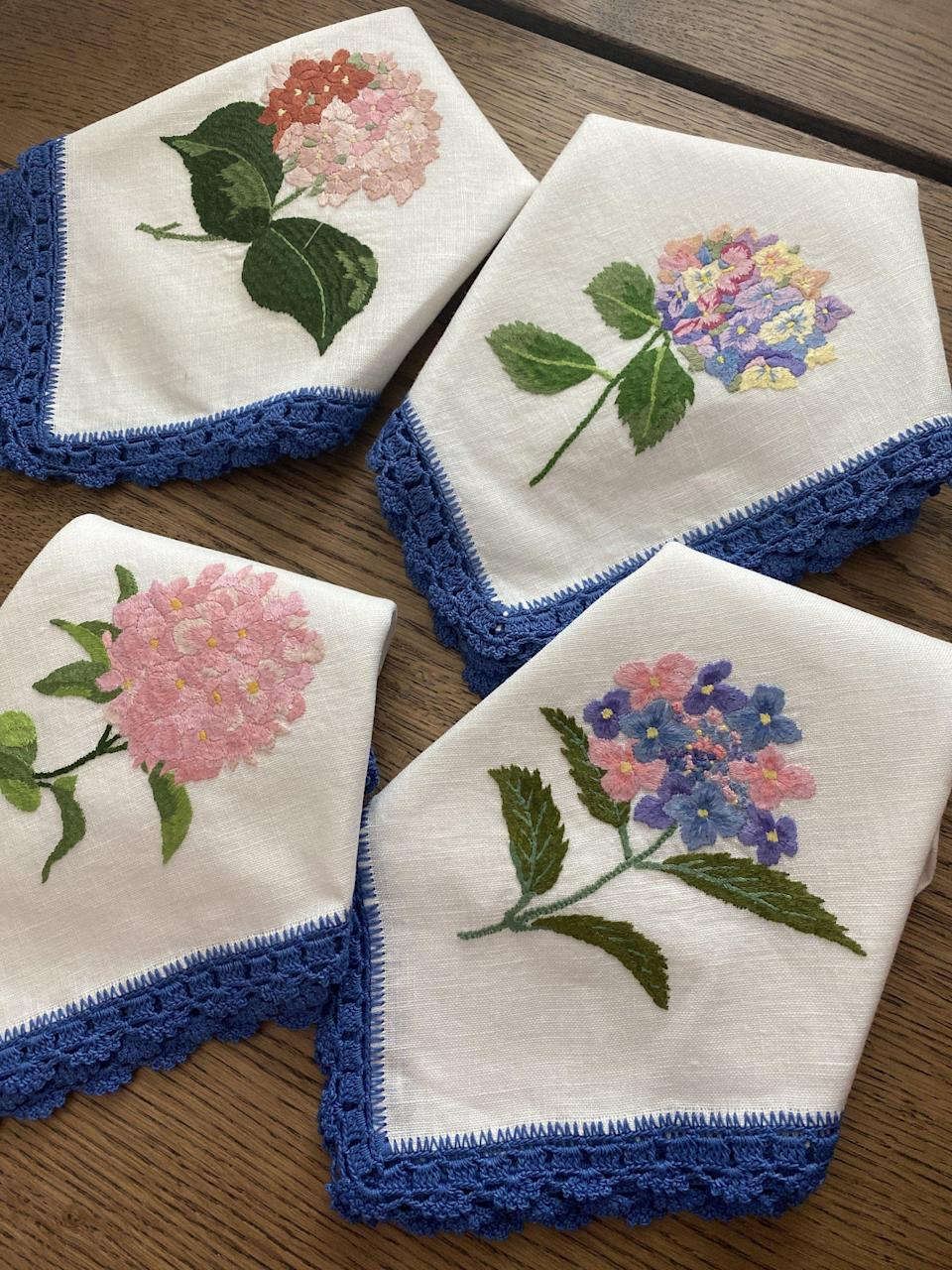 """<p>hibiscuslinens.com</p><p><strong>$800.00</strong></p><p><a href=""""https://www.hibiscuslinens.com/collections/signature-collection/products/hydrangea-napkins-set-of-4"""" rel=""""nofollow noopener"""" target=""""_blank"""" data-ylk=""""slk:Shop Now"""" class=""""link rapid-noclick-resp"""">Shop Now</a></p><p>""""The more I stay home and work remotely, the more I love the idea of decorating my space with special pieces like these Hydrangea Dinner Napkins. I am already looking forward to future dinner parties at home with my closest friends. The brand, Hibiscus Linens, offers the option for made-to-order pieces for that extra special touch! They also offer classes to learn about the traditional Mexican needlework technique used in their designs.""""—<em>Dania Ortiz, Fashion and Accessories Director</em></p>"""