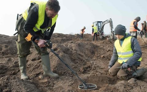 <span>Amateur archaeologist Rene Schoen, left, and 13-year-old student Luca Malaschnichenko at the dig where the coins were found</span> <span>Credit: STEFAN SAUER/ DPA </span>