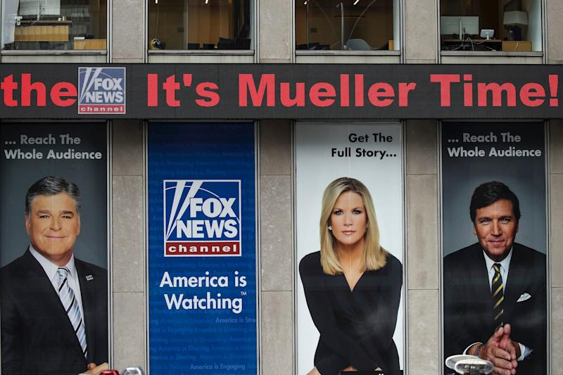 The news ticker at Fox News headquarters scrolls headlines before Special Counsel Robert Mueller makes a statement about the Russia investigation, May 29, 2019 in New York City.