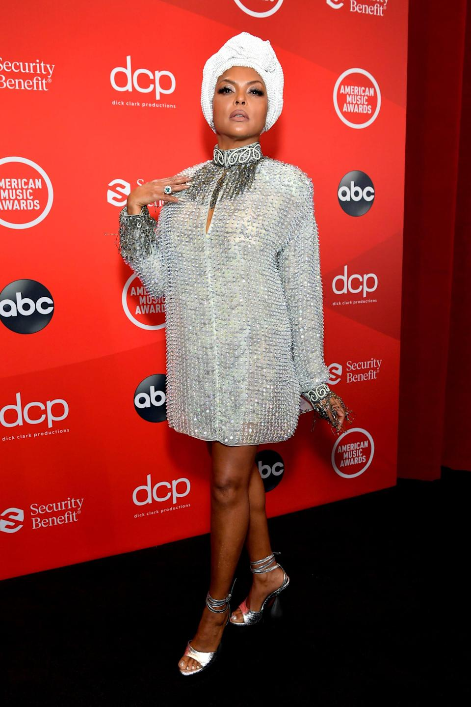 "<p><a href=""https://www.popsugar.com/fashion/taraji-p-henson-american-music-awards-2020-dress-47994656"" class=""link rapid-noclick-resp"" rel=""nofollow noopener"" target=""_blank"" data-ylk=""slk:Wearing Giorgio Armani"">Wearing Giorgio Armani</a> with jewels by Roberto Coin and Tiffany & Co. and Tom Ford heels.</p>"