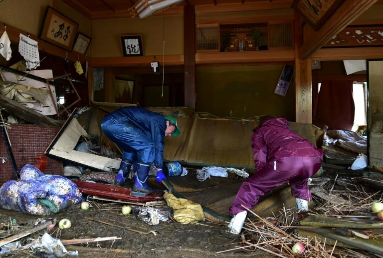 With thousands of Japanese homes without power and tens of thousands more lacking water after Typhoon Hagibis, residents clean their flood-damaged residence in Nagano