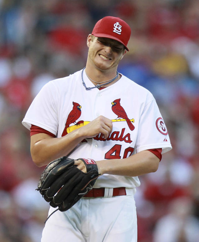 St. Louis Cardinals starting pitcher Shelby Miller reacts after being hit on his throwing arm by a line drive from the first batter in the game, Los Angeles Dodgers' Carl Crawford, during a baseball game Wednesday, Aug. 7, 2013, in St. Louis. Miller left the game. (AP Photo/St. Louis Post-Dispatch, Chris Lee)
