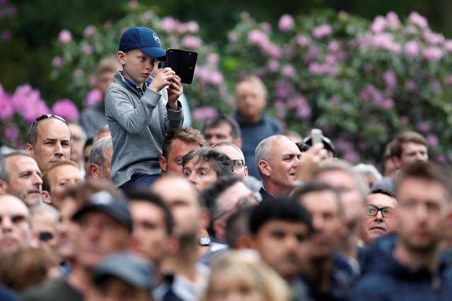 Golf - European Tour - BMW PGA Championship - Wentworth Club, Virginia Water, Britain - May 25, 2018 A young spectator takes a photograph during the second round Action Images via Reuters/Paul Childs