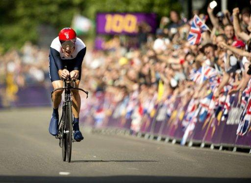 Britain's gold medalist Bradley Wiggins approaches the finish line as he competes in the London 2012 Olympic Games men's individual time trial road cycling event in London