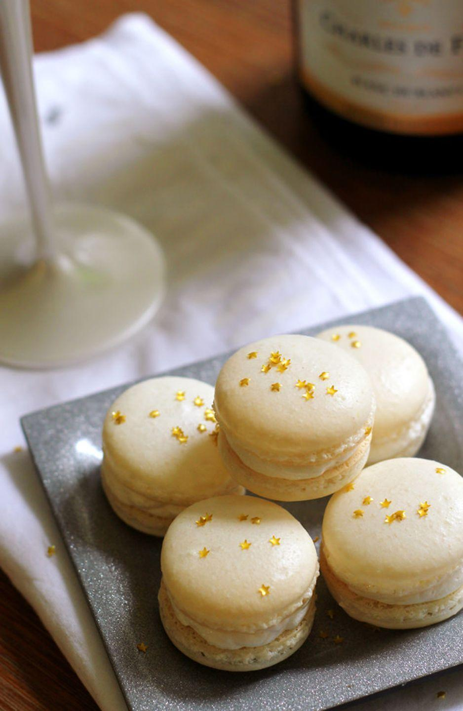 """<p>Bring a little French flavor to your Mother's Day celebration. Made with Champagne-infused buttercream, these macarons are a decadent treat Mom definitely deserves. </p><p><strong>Get the recipe at <a href=""""https://joanne-eatswellwithothers.com/2014/12/champagne-macarons.html"""" rel=""""nofollow noopener"""" target=""""_blank"""" data-ylk=""""slk:Eats Well With Others"""" class=""""link rapid-noclick-resp"""">Eats Well With Others</a>.</strong></p><p><a class=""""link rapid-noclick-resp"""" href=""""https://www.amazon.com/Ateco-3124-Plastic-Decorating-Reusable/dp/B000638B34?tag=syn-yahoo-20&ascsubtag=%5Bartid%7C10050.g.4238%5Bsrc%7Cyahoo-us"""" rel=""""nofollow noopener"""" target=""""_blank"""" data-ylk=""""slk:SHOP PIPING BAGS"""">SHOP PIPING BAGS</a> </p>"""