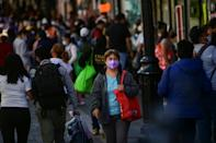 Crowds still gather in the streets and on public transport in Mexico City despite an official halt to most non-essential activities