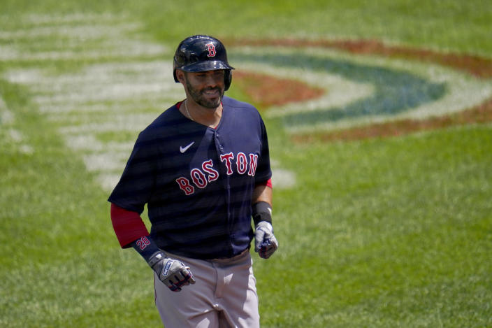 Boston Red Sox's J.D. Martinez trots to the dugout after hitting a solo home run off Baltimore Orioles starting pitcher Jorge Lopez during the third inning of a baseball game, Sunday, April 11, 2021, in Baltimore. (AP Photo/Julio Cortez)