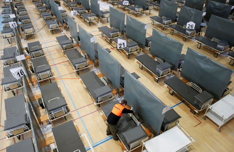 A civil defence worker prepares a bed of the Medical Center Luzern which can offer some 220 additional beds for patients of the coronavirus disease (COVID-19) in Nottwil