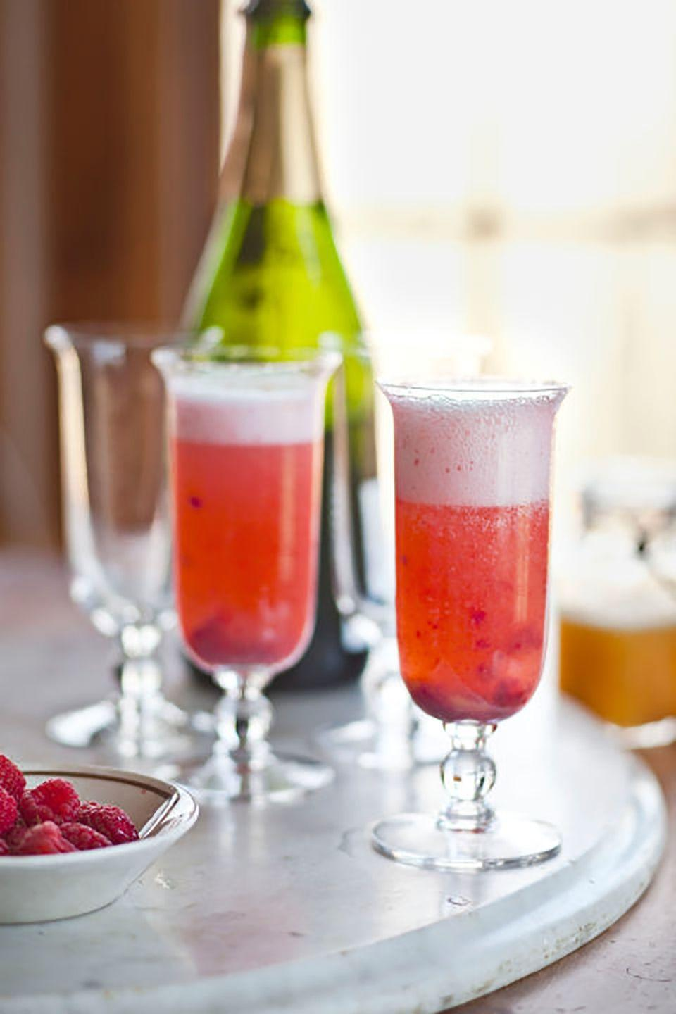 """<p>Sweet berries and peaches add a new twist to the classic mimosa, a perfect treat for celebrating her special day.</p><p><strong><a href=""""https://www.countryliving.com/food-drinks/recipes/a4118/peach-melba-mimosas-recipe-clv0212/"""" rel=""""nofollow noopener"""" target=""""_blank"""" data-ylk=""""slk:Get the recipe"""" class=""""link rapid-noclick-resp"""">Get the recipe</a>.</strong></p>"""