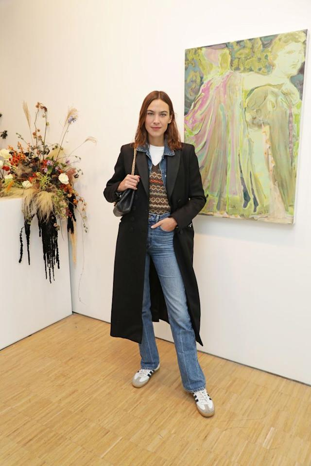 <p>At a recent art exhibition at the Cob Gallery in North London, Chung modelled a classic double-denim look elevated by a formal jacket that she layered over a simple sweater to add a hint of pattern.</p>