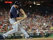 Atlanta Braves' Evan Gattis hits a two-run single during the fifth inning of a baseball game against the Washington Nationals at Nationals Park Tuesday, Aug. 6, 2013, in Washington. (AP Photo/Alex Brandon)