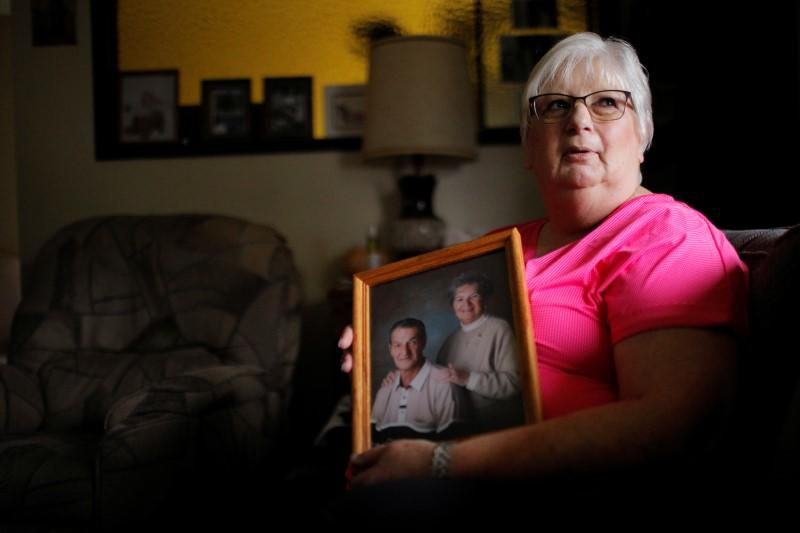 Debbie de los Angeles, whose mother died from coronavirus disease, poses for a portrait at her home in Monroe