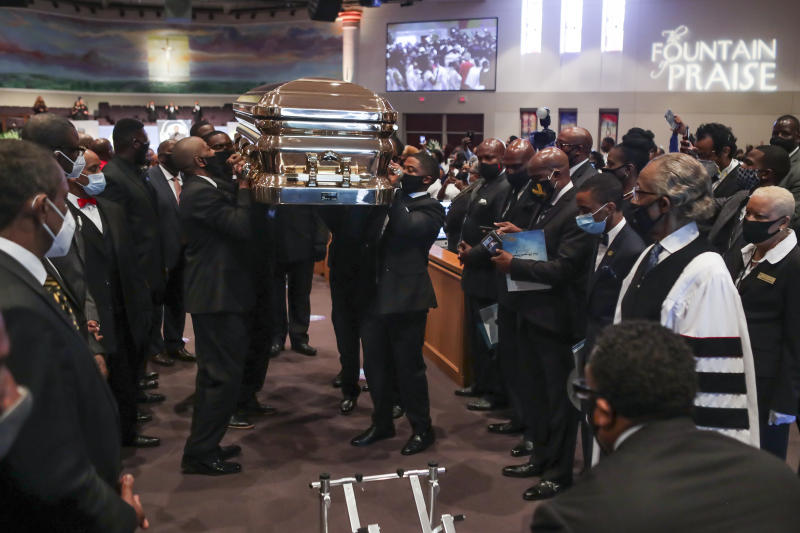 HOUSTON, TX - JUNE 09: Pallbearers recess out of the church with the casket following the funeral for George Floyd at The Fountain of Praise church on June 9, 2020 in Houston, Texas. Floyd died after being restrained by Minneapolis Police officers on May 25, sparking global protests. (Photo by Godofredo A. Vásquez - Pool/Getty Images)