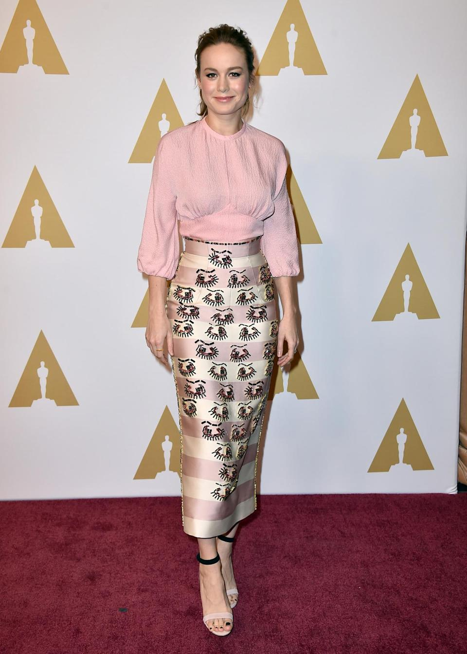"""<p>Brie Larson, who's nominated for her first Oscar in the best actress category, was very fashion-forward at her first nominees luncheon wearing a pink and white striped skirt with a flouncy blouse. While she looked beautiful, others wanted to know about Jacob Tremblay's sexy parent. """"Hot dad is here just so everyone is aware,"""" she said. """"It's been going on quietly for a while and it's really amazing how the Internet has finally caught on almost a year later."""" <i>Photo: AP</i></p>"""