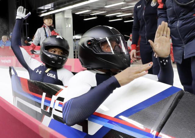 Driver Elana Meyers Taylor and Lauren Gibbs of the United States celebrate after their silver medal winning heat during the women's two-man bobsled final at the 2018 Winter Olympics in PyeongChang, South Korea, Wednesday, Feb. 21, 2018. (AP)