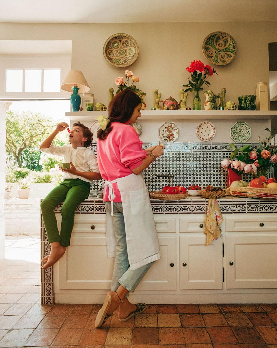 "<div class=""caption"">De Castellane and her son Vadim in the kitchen. Backsplash of vintage tile.</div><cite class=""credit"">Matthieu Salvaing</cite>"